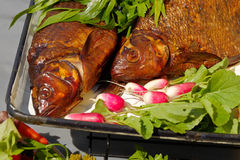 Smoked fish with young radish and parsley Stock Photo