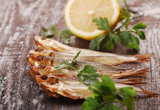 Smoked fishes with herbs Royalty Free Stock Images