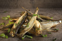 Smoked fishes with herbs Stock Photos