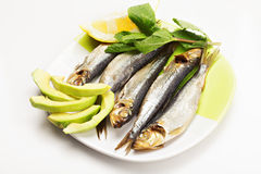 Smoked fishes on plate Stock Photography