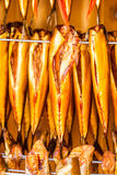 Smoked fresh fish in smokehouse Stock Photo