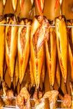 Smoked fresh fish in smokehouse Stock Photo