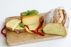 Smoked full fat cheese 1. Smoked full fat cheese, a couple of slices and piece, healthy homemade bread, fresh red pepper and fresh, green basil leaves on grunge Stock Images