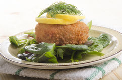 Smoked haddock fishcake on salad Stock Images