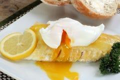 Smoked haddock with a poached egg. Fish smoked haddock topped with a poached egg Royalty Free Stock Photos