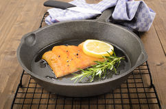 Smoked haddock with rosemary and a lemon slice Stock Photos