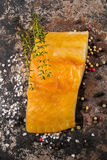 Smoked haddock with thyme, peppercorn and salt. Smoked haddock with thyme, peppercorn and coarse salt on old metal Royalty Free Stock Image