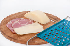 Smoked ham with cheese in one piece and grater Royalty Free Stock Images