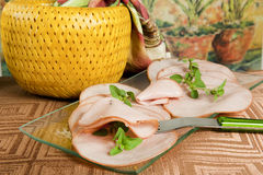Smoked ham with grass. Some slices of smoked ham with grass Royalty Free Stock Images