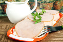 Smoked ham with grass. Some slices of smoked ham with grass Royalty Free Stock Photos