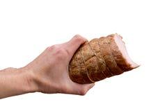 Smoked ham in hands Stock Photos