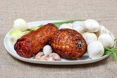 Smoked ham, mushrooms and garlic Royalty Free Stock Photography