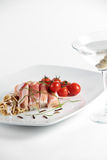 Smoked ham rolls served with a drink Royalty Free Stock Photos