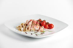 Smoked ham rolls with vegetables Royalty Free Stock Image