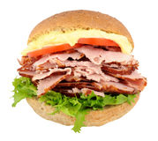 Smoked Ham And Salad Sandwich. Fresh smoked ham and salad sandwich roll with mayonnaise  on a white background Royalty Free Stock Image