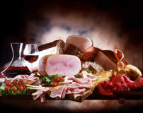 Smoked ham and sausages. Sausages arrangement in pictorial style Royalty Free Stock Photos