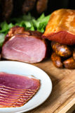 Smoked ham with schwarzwald ham and prosciutto Stock Photo