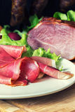 Smoked ham with schwarzwald ham and prosciutto Royalty Free Stock Photography