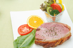 Smoked ham stack with fruit and vegetable salad Royalty Free Stock Image