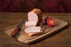 Smoked ham on the table. Composition with smoked ham on the table Royalty Free Stock Image