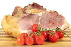 Smoked ham and tomatoes Stock Photography