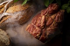 Smoked ham. Traditional, homely smoked meat and homemade bread. stock photo