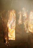 Smoked ham in a traditional way in the smokehouse Stock Photo
