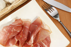 Smoked ham on a white plate Stock Images