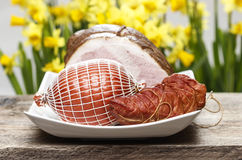 Smoked ham on wooden table Stock Photography