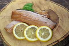 Smoked herring fillets. With lemon and basil Royalty Free Stock Images