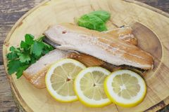 Smoked herring fillets. With lemon and basil Stock Photography