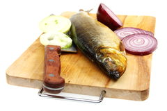 Smoked herring on the kitchen board. Stock Photo