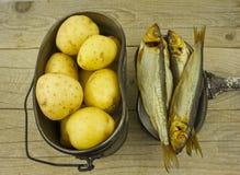 Smoked herring, and potatoes, camp food Royalty Free Stock Photos