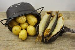 Smoked herring and potatoes, camp food Stock Photo