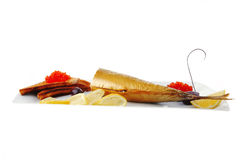 Smoked herring and red caviar Royalty Free Stock Image