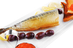 Smoked herring and red caviar Stock Images