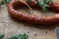 Smoked homemade sausage on a chopping board Royalty Free Stock Photo