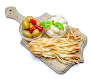Smoked and Italian mozzarella cheese, olives, pepper on wooden cutting board. White background Royalty Free Stock Photos