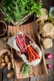 Smoked kabanos sausages in basket stock photo