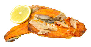 Smoked Kipper Fillets. Traditional grilled smoked kipper fillets isolated on a white background Stock Photography