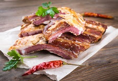 Smoked lamb ribs on wooden royalty free stock photo