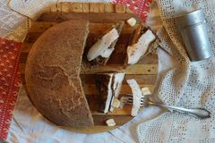 Smoked lard with spice and bread  on the board Stock Photography