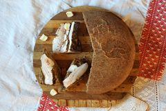 Smoked lard with spice and different bread. On the board Royalty Free Stock Image