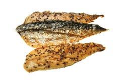Smoked mackerel. Smoked and peppered mackerel fillets isolated on white stock image