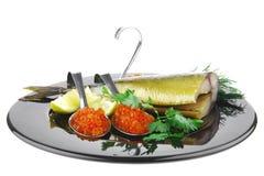 Smoked mackerel on black Stock Image