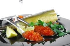 Smoked mackerel on black Royalty Free Stock Photo