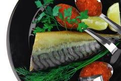 Smoked mackerel on black Royalty Free Stock Image