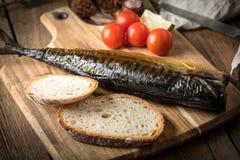 Smoked mackerel and bread. royalty free stock photography