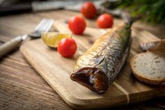 Smoked mackerel and bread. royalty free stock image