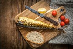 Smoked mackerel and bread royalty free stock photo
